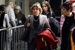 Attorney Gloria Allred, center, leaves the courtroom of the Harvey Weinstein rape trial during the lunch break, in New York, Thursday, Feb. 13, 2020. (AP Photo/Richard Drew)