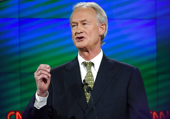 """FILE - In this Oct. 13, 2015, file photo, former Rhode Island Gov. Lincoln Chafee speaks during a Democratic presidential debate in Las Vegas. Former Democratic presidential candidate Chafee filed to run for president as a Libertarian. Chafee on Sunday, Jan. 5, 2020 registered the """"Lincoln Chafee For President"""" campaign committee with the Federal Election Commission, online records showed. (AP Photo/John Locher, File)"""
