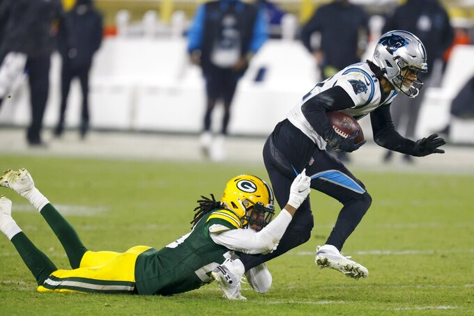Green Bay Packers' Kevin King tries to stop Carolina Panthers' Robby Anderson during the second half of an NFL football game Saturday, Dec. 19, 2020, in Green Bay, Wis. (AP Photo/Matt Ludtke)