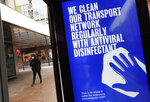 A digital display on a bus stop informs passengers of cleaning protocols to prevent the spread of COVID-19 in Oxford Street in London, Tuesday, Jan. 26, 2021. The U.K. will soon become the fifth country in the world to record 100,000 COVID-19 deaths, after the United States, Brazil, India and Mexico — all of which have much larger populations than Britain's 67 million people. As of Monday, the U.K.'s official coronavirus death toll was 98,531. (AP Photo/Alastair Grant)