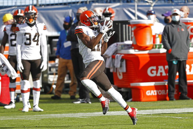 Cleveland Browns wide receiver Donovan Peoples-Jones (11) catches a 75-yard touchdown pass against the Tennessee Titans in the first half of an NFL football game Sunday, Dec. 6, 2020, in Nashville, Tenn. (AP Photo/Wade Payne)