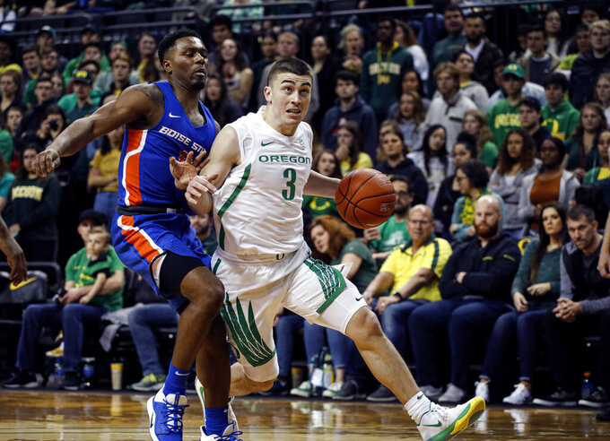 Oregon guard Payton Pritchard (3) drives on Boise State in an NCAA college basketball game Saturday, Nov. 9, 2019, in Eugene, Ore. (AP Photo/Thomas Boyd)