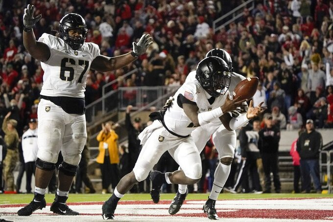 Army's Tyhier Tyler reacts after running for a touchdown during the second half of an NCAA college football game against Wisconsin Saturday, Oct. 16, 2021, in Madison, Wis. (AP Photo/Morry Gash)