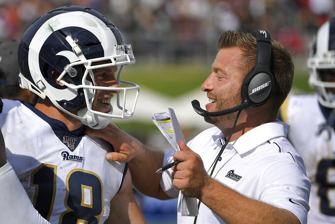 Los Angeles Rams wide receiver Cooper Kupp celebrates after a long run with head coach Sean McVay during the second half of an NFL football game New Orleans Saints Sunday, Sept. 15, 2019, in Los Angeles. (AP Photo/Mark J. Terrill)