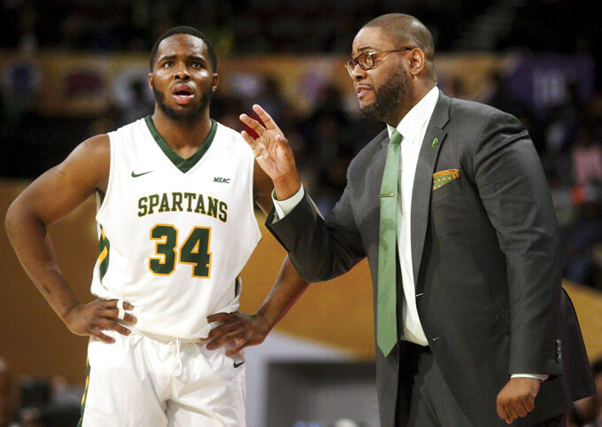 Norfolk State's head coach Robert Jones talks with Steven Whitley during an NCAA college basketball game against North Carolina Central in the championship of the Mid-Eastern Athletic Conference tournament, Saturday, March 16, 2019, in Norfolk, Va. (AP Photo/Jason Hirschfeld)