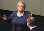 In this photo taken Nov. 12, 2019 in Poland's parliament in Warsaw, Poland, the head of Poland's Supreme Court, Malgorzata Gersdorf,left, talks to Poland's Ombudsman Adam Bodnar. On Tuesday, 19 November 2019, Gersdorf greeted as success a ruling by the European Court of Justice that tasked Poland's Supreme Court with vetting the legality of its new, politically-appointed Disciplinary Chamber. The Supreme Court had sought the EU's court's ruling on the matter. (AP Photo/Czarek Sokolowski)