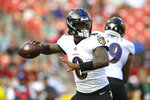 Baltimore Ravens quarterback Lamar Jackson looks downfield before throwing the ball against the Washington Football Team during the first half of a preseason NFL football game, Saturday, Aug. 28, 2021, in Landover, Md. (AP Photo/Nick Wass)