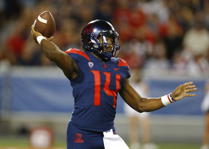 FILE - In this Sept. 15, 2018, file photo, Arizona quarterback Khalil Tate passes in the first half of an NCAA college football game against Southern Utah in Tucson, Ariz. The last time he faced Oregon State, Tate rushed for more than 200 yards and two touchdowns. When he sees the Beavers on Saturday, Sept. 22, 2018, he may have to rely more on his arm. (AP Photo/Rick Scuteri, file)