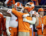 Clemson head coach Dabo Swinney celebrates with players during the second half of the NCAA college football playoff championship game against Alabama, Monday, Jan. 7, 2019, in Santa Clara, Calif. (AP Photo/Chris Carlson)