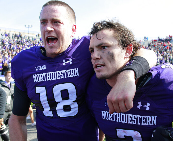 Northwestern's Clayton Thorson, left, and Flynn Nagel celebrate their team's win over Nebraska in an NCAA college football game Saturday, Oct. 13, 2018, in Evanston, Ill.. (AP Photo/Jim Young)