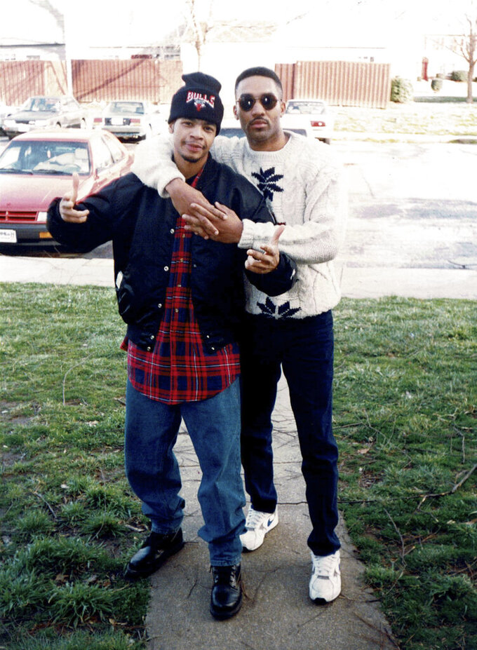 This early 1990's photo provided by musician DJ Nabs shows him, left, with his childhood friend, Alton Lucas in North Carolina. (Courtesy DJ Nabs via AP)