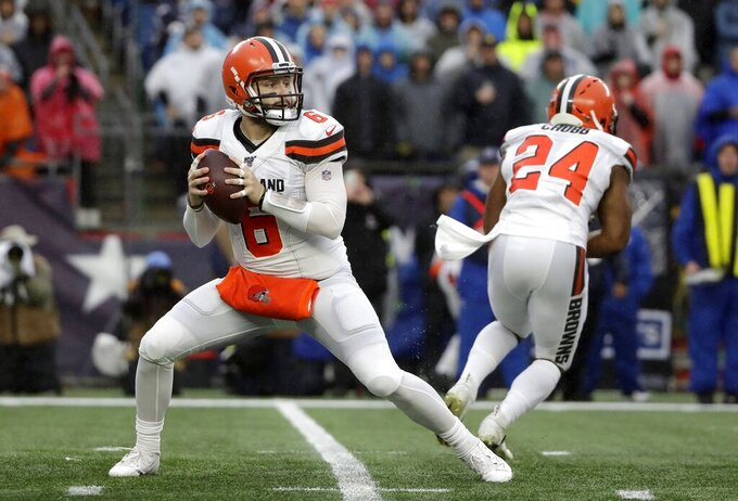 Cleveland Browns quarterback Baker Mayfield drops back to pass against the New England Patriots in the first half of an NFL football game, Sunday, Oct. 27, 2019, in Foxborough, Mass. (AP Photo/Elise Amendola)
