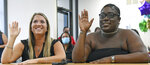 ADVANCE FOR PUBLICATION ON SUNDAY, MAY 16, AND THEREAFTER - LeahPaskalides, left, and MonyayFaith Randall are sworn in on April 27, 2021, in Bradenton, Fla., during a Zoom adoption hearingwhere 12thJudicialCircuitJudge Teresa Dees ruled over the roughly six-minute hearing in whichMonyayFaith Randall officially becameMonyayFaithPaskalides. (Thomas Bender/Sarasota Herald-Tribune via AP)
