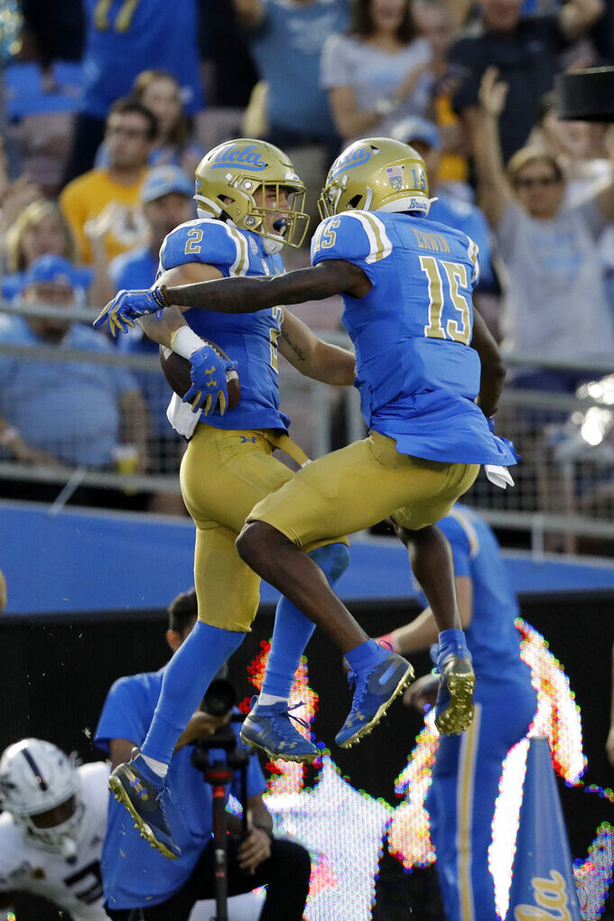UCLA wide receiver Kyle Philips (2) celebrates his touchdown catch with wide receiver Jaylen Erwin (15) during the first half of an NCAA college football game against Arizona State Saturday, Oct. 26, 2019, in Pasadena, Calif. (AP Photo/Marcio Jose Sanchez)