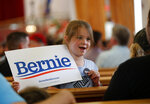 Prosper Hicks, 6, shows off her button as she waits for a town hall event with Democratic presidential candidate Sen. Bernie Sanders, I-Vt., at the Victory Missionary Baptist Church in Las Vegas on Saturday, July 6, 2019. (Steve Marcus/Las Vegas Sun via AP)