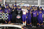 Denny Hamlin, center, celebrates with crew members after winning the NASCAR Daytona 500 auto race at Daytona International Speedway, Monday, Feb. 17, 2020, in Daytona Beach, Fla. (AP Photo/Terry Renna)