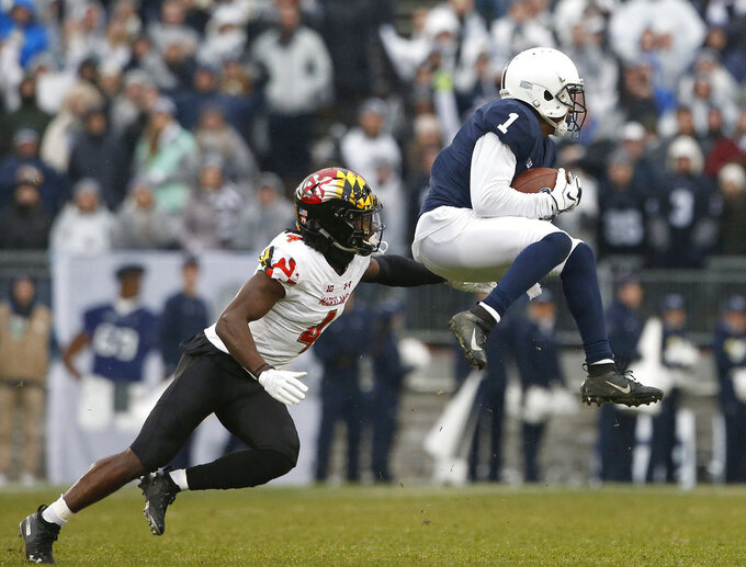 Penn State's KJ Hamler (1) catches a pass in front of Maryland's Darnell Savage Jr. (4) during the first half of an NCAA college football game in State College, Pa., Saturday, Nov. 24, 2018. (AP Photo/Chris Knight)