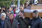 Men carry a coffin during a funeral of an earthquake victim in Durres, western Albania, Friday, Nov. 29, 2019. The operation to find survivors and recover bodies from Albania's deadly earthquake was winding down Friday as the death toll climbed to 49. (AP Photo/Visar Kryeziu)
