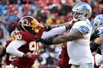 Washington Redskins linebacker Montez Sweat (90) is blocked by Detroit Lions offensive tackle Taylor Decker (68) during the second half of an NFL football game, Sunday, Nov. 24, 2019, in Landover, Md. (AP Photo/Mark Tenally)