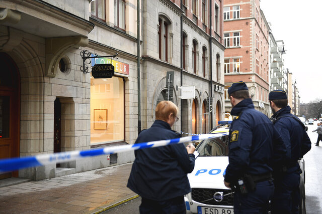 Police at the scene after items were stolen from an exhibition at an art gallery in Stockholm, Sweden, Thursday, Jan. 30, 2020. Police in Sweden say at least two thieves have stolen items from an art gallery in central Stockholm. Swedish media report the missing artwork includes 10 to 12 table-size bronze sculptures by Spanish artist Salvador Dali. (Ali Lorestani/TT News Agency via AP)