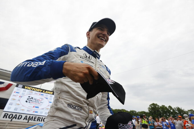 Alex Palou celebrates after winning an IndyCar race at Road America in Elkhart Lake, Wisc., Sunday, June 20, 2021. (AP Photo/Jeffrey Phelps)