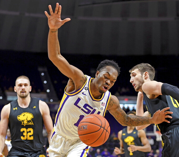 LSU guard Ja'vonte Smart (1) loses the handle after being fouled by UMBC guard Brandon Horvath, right, as UMBC forward Dimitrije Spasojevic (32) watches during the first half of an NCAA college basketball game, Tuesday, Nov. 19, 2019, in Baton Rouge, La. (AP Photo/Bill Feig)