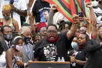 Jacob Blake Sr., father of Jacob Blake, raises his fist in the air while speaking at the March on Washington, Friday Aug. 28, 2020, at the Lincoln Memorial in Washington. (AP Photo/Jacquelyn Martin, Pool)