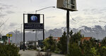 This May 24, 2021, photo shows the sign for the Open Door Baptist Church along a highway leading into Anchorage, Alaska. The church has replaced a strip club that used to beckon people off the highway. (AP Photo/Mark Thiessen)