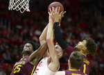 Utah center Branden Carlson (35) is pressured by Minnesota center Daniel Oturu (25) and guard Tre' Williams (1) during an NCAA college basketball game Friday, Nov. 15, 2019, in Salt Lake City. (Francisco Kjolseth/The Salt Lake Tribune via AP)