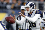 Los Angeles Rams quarterback Jared Goff (16) takes a snap during the first half of an NFL football game against the Pittsburgh Steelers in Pittsburgh, Sunday, Nov. 10, 2019. (AP Photo/Keith Srakocic)