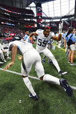 Tennessee Titans inside linebacker Wesley Woodyard (59) dances on the sidelines with players during the second half of an NFL football game against the Atlanta Falcons, Sunday, Sept. 29, 2019, in Atlanta. The Tennessee Titans won 24-10. (AP Photo/John Amis)