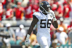 FILE - In this Sept. 8, 2019, file photo, Jacksonville Jaguars linebacker Quincy Williams (56) walks off the field during an NFL football game against the Kansas City Chiefs in Jacksonville, Fla. Brothers and NFL rookies Quinnen and Quincy Williams have more than 60 friends and family members coming to the first game of their lives on opposing teams when the Jets and Jaguars meet. (AP Photo/Perry Knotts, File)