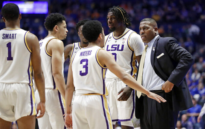 LSU interim head coach Tony Benford talks with his players in the second half of an NCAA college basketball game against Florida at the Southeastern Conference tournament Friday, March 15, 2019, in Nashville, Tenn. Florida won 76-73. (AP Photo/Mark Humphrey)