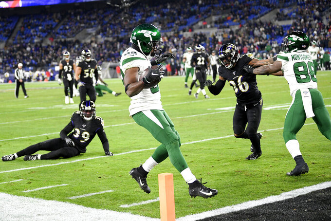 New York Jets wide receiver Jamison Crowder, center, scores on a touchdown pass from quarterback Sam Darnold, not visible, during the second half of an NFL football game against the Baltimore Ravens, Thursday, Dec. 12, 2019, in Baltimore. (AP Photo/Nick Wass)