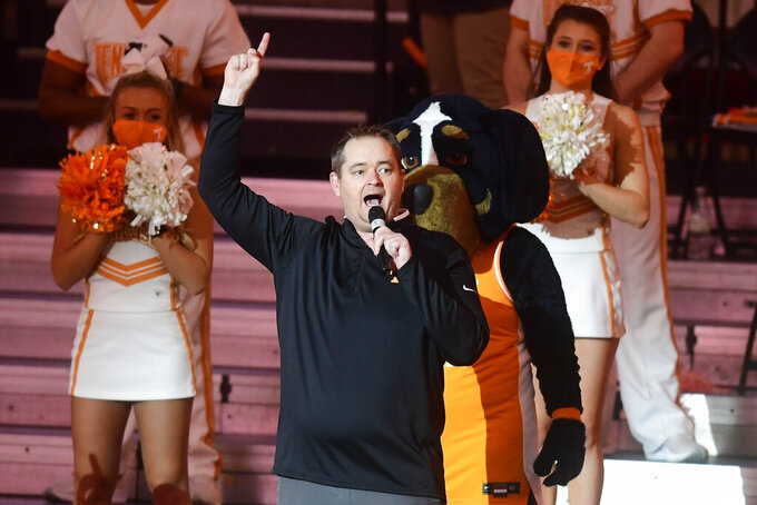 New Tennessee football coach Josh Heupel speaks during a college basketball game between Tennessee and Kansas in Knoxville, Tenn., Saturday, Jan. 30, 2021. (Caitie McMekin/Knoxville News Sentinel via AP, Pool)