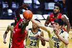 Maryland guard Eric Ayala (5) tries to pull in a rebound in front of Purdue center Zach Edey (15) during the first half of an NCAA college basketball game in West Lafayette, Ind., Friday, Dec. 25, 2020. (AP Photo/Michael Conroy)