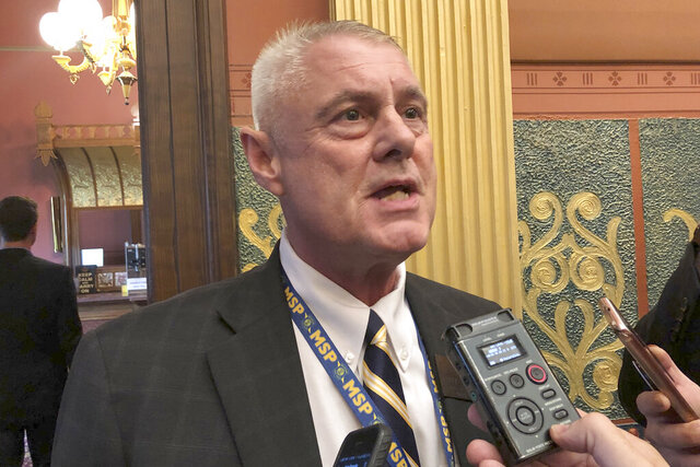 FILE - In a Tuesday, Sept. 3, 2019 file photo, State Rep. Larry Inman, R-Williamsburg, speaks with reporters, in the House chamber in Lansing, Mich. The Michigan Supreme Court ordered Monday, Dec. 30, 2019 that an attempt to recall Inman from office continue, reversing a lower court that said election officials correctly disqualified the petition over a missing word. (AP Photo/David Eggert, File)