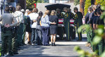 As family and members of the Big Bear Hotshots stand by, U.S. Forest Service pallbearers move the casket of the fallen Big Bear Interagency Hotshot Charles Morton at the Ferrara Colonia Mortuary in Orange, Calif., following a procession from San Bernardino on Tuesday, Sept. 22, 2020. Morton died on September 17 while battling the El Dorado Fire in the San Bernardino National Forest. (Mark Rightmire/The Orange County Register via AP)