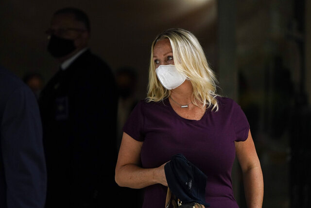 Margaret Hunter, the wife of former California Republican Rep. Duncan Hunter, leaves a federal building Monday, Aug. 24, 2020, in San Diego. She was sentenced Monday in federal court to eight months of home confinement in the corruption case that ended her husband's career. (AP Photo/Gregory Bull)