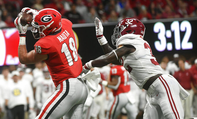 Georgia tight end Isaac Nauta (18) makes a touchdown catch against Alabama linebacker Dylan Moses (32) during the first half of the Southeastern Conference championship NCAA college football game, Saturday, Dec. 1, 2018, in Atlanta. (AP Photo/John Amis)