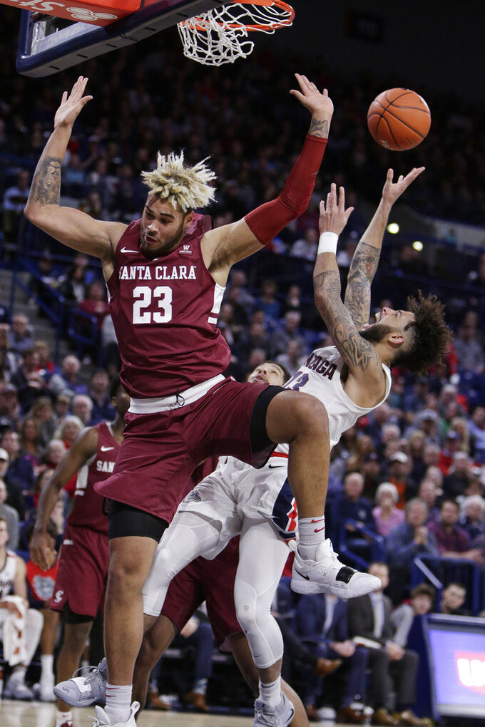 Gonzaga guard Josh Perkins, right, shoots and is fouled by Santa Clara center Zeke Richards (23) during the second half of an NCAA college basketball game in Spokane, Wash., Saturday, Jan. 5, 2019.  (AP Photo/Young Kwak)