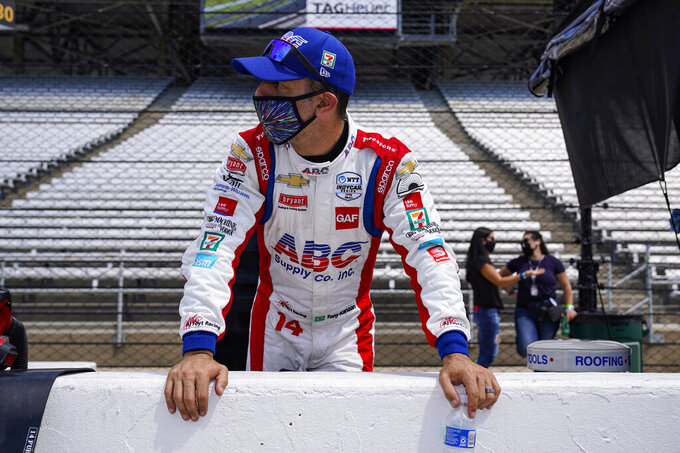 Tony Kanaan, of Brazil, looks down the pit lane during practice for the Indianapolis 500 auto race at Indianapolis Motor Speedway in Indianapolis, Friday, Aug. 14, 2020. (AP Photo/Michael Conroy)