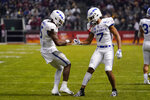 Air Force quarterback Donald Hammond III celebrates with Geraud Sanders (7) after scoring a touchdown against Washington State during the first half during the Cheez-It Bowl NCAA college football game Friday, Dec. 27, 2019, in Phoenix. (AP Photo/Rick Scuteri)