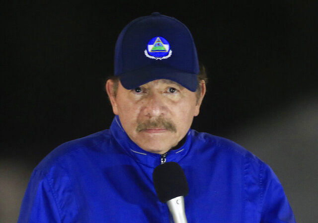 FILE - In this  March 21, 2019 file photo, Nicaragua's President Daniel Ortega speaks during the inauguration ceremony of a highway overpass in Managua, Nicaragua. After not appearing in public for 34 days, Ortega spoke to the nation on Wednesday, April 15, 2020, and said that the country is fighting patiently against the new coronavirus pandemic. (AP Photo/Alfredo Zuniga, File)