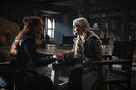 This image released by HBO shows Sophie Turner, left, Emilia Clarke in a scene from