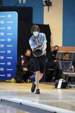 """Critical care nurse and professional bowler Erin McCarthy competes at the 2021 PWBA Kickoff Classic Series in Arlington, Texas, on Jan. 26, 2021. """"You have to have a calm demeanor and think clearly,"""" McCarthy says. """"I think that's probably why I love doing them both equally as much."""" (USBC via AP)"""
