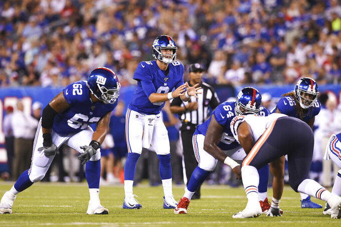 FILE - In this Friday, Aug. 16, 2019, file photo, New York Giants quarterback Daniel Jones (8) waits for the snap against the Chicago Bears during the second quarter of a preseason NFL football game in East Rutherford, N.J. Eli Manning is on the bubble and everyone is waiting to see when Daniel Jones, the No. 6 pick overall, takes over. (AP Photo/Sarah Stier, File)
