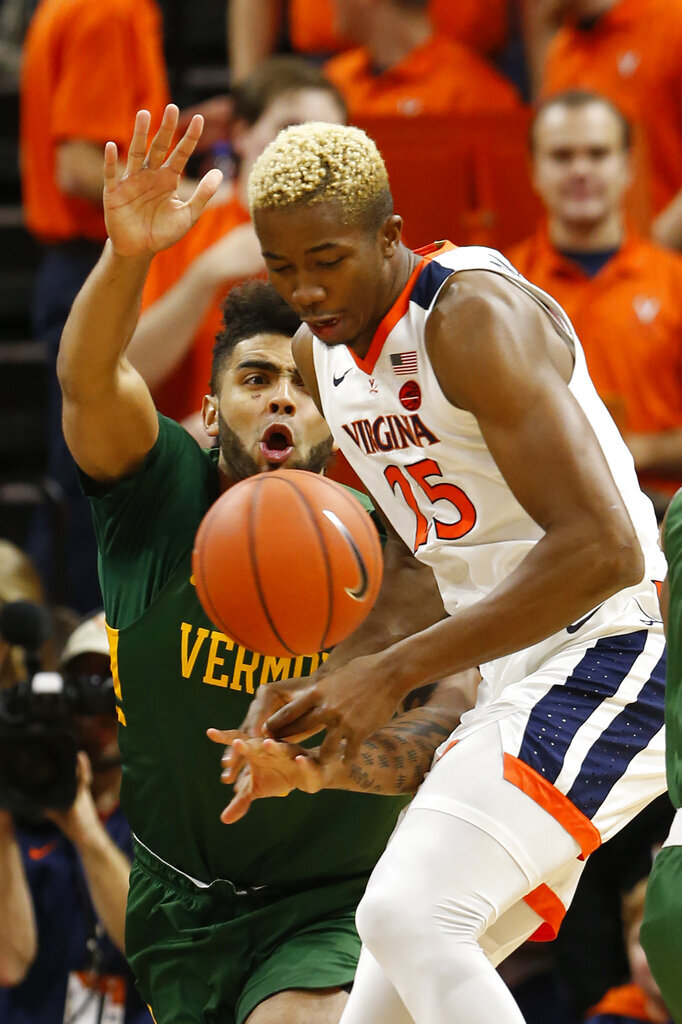 Virginia forward Mamadi Diakite (25) loses the ball as Vermont forward Anthony Lamb (3) applies pressure during the first half of an NCAA college basketball game Tuesday, Nov. 19, 2019, in Charlottesville, Va.. (AP Photo/Steve Helber)