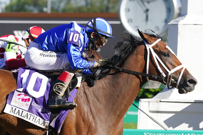 John Velazquez rides Malathaat to victory during the 147th running of the Kentucky Oaks at Churchill Downs, Friday, April 30, 2021, in Louisville, Ky. (AP Photo/Darron Cummings)