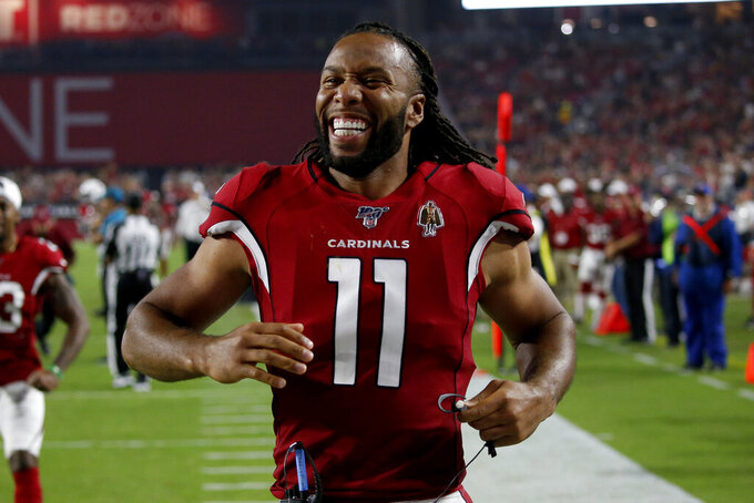 Arizona Cardinals wide receiver Larry Fitzgerald (11) celebrates wide receiver Damiere Byrd scored a touchdown against the Los Angeles Chargers during the first half of an NFL preseason football game, Thursday, Aug. 8, 2019, in Glendale, Ariz. (AP Photo/Ross D. Franklin)